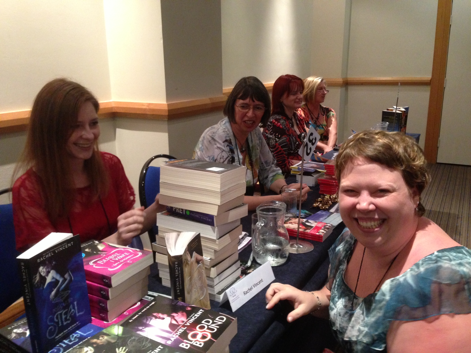Me and my mountain of Rachel Vincent books, in front of poor Rachel Vincent at the last ARRA Conference.