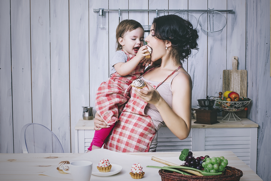Mother And Small Child In The Kitchen At Home Beautiful And Happ
